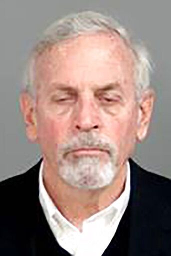 This photo provided by the Genesee County Sheriff's Office in Flint, Mich., shows Gerald Ambrose, the former Flint Emergency Manager, who was charged with four counts of misconduct in office on Thursday, Jan. 14, 2021, in connection with the Flint water crisis in Flint, Mich. (Genesee County Sheriff's Office via AP)