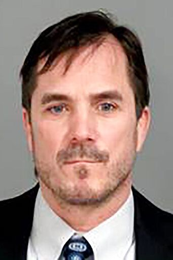 This image provided by the Genesee County, Mich., Sheriff's Office, shows Nicolas Lyon, the former Michigan Health Department Director, who was charged with nine counts of involuntary manslaughter, and a misdemeanor charge of willful neglect of duty in office, Thursday, Jan. 14, 2021 in connection with the Flint, Mich., water crisis. (Genesee County Sheriff's Office via AP)