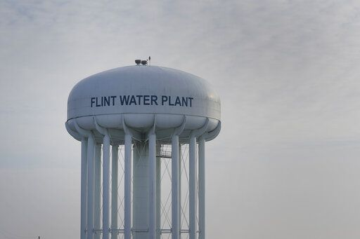 The Flint Water Plant tower is shown in Flint, Mich., Wednesday, Jan. 13, 2021.  Some Flint residents impacted by months of lead-tainted water are looking past expected charges against former Gov. Rick Snyder and others in his administration to healing physical and emotional damages left by the crisis.