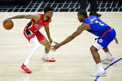 Los Angeles Clippers forward Kawhi Leonard (2) defends against New Orleans Pelicans guard Nickeil Alexander-Walker (6) during the second quarter of an NBA basketball game Wednesday, Jan. 13, 2021, in Los Angeles.