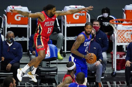 New Orleans Pelicans guard Sindarius Thornwell (15) defends against Los Angeles Clippers guard Paul George (13) during the third quarter of an NBA basketball game Wednesday, Jan. 13, 2021, in Los Angeles.