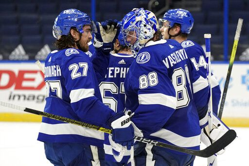 Tampa Bay Lightning goaltender Andrei Vasilevskiy (88) celebrates with defenseman Ryan McDonagh (27) after the team defeated the Chicago Blackhawks during an NHL hockey game Wednesday, Jan. 13, 2021, in Tampa, Fla.