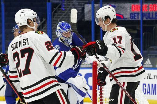 Chicago Blackhawks center Dylan Strome (17) celebrates with defenseman Adam Boqvist (27) after Strome scored against the Tampa Bay Lightning during the third period of an NHL hockey game Wednesday, Jan. 13, 2021, in Tampa, Fla.