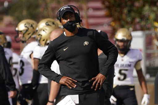 FILE -  In this Nov. 14, 2020, file photo, Colorado head coach Karl Dorrell stands on the sideline during the first half of an NCAA college football game against Stanford in Stanford, Calif. First-year Colorado coach Dorrell has the Buffaloes in a bowl for the first time since 2016.