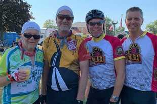 "2019 RAGBRAI riders in West Point, Iowa. Pictured, from left, are columnist Ralph Banasiak, Tom Lucas, Kevin Mikolajewski of Hoffman Estates and Greg ""Lemond"" Sammons of Palatine."