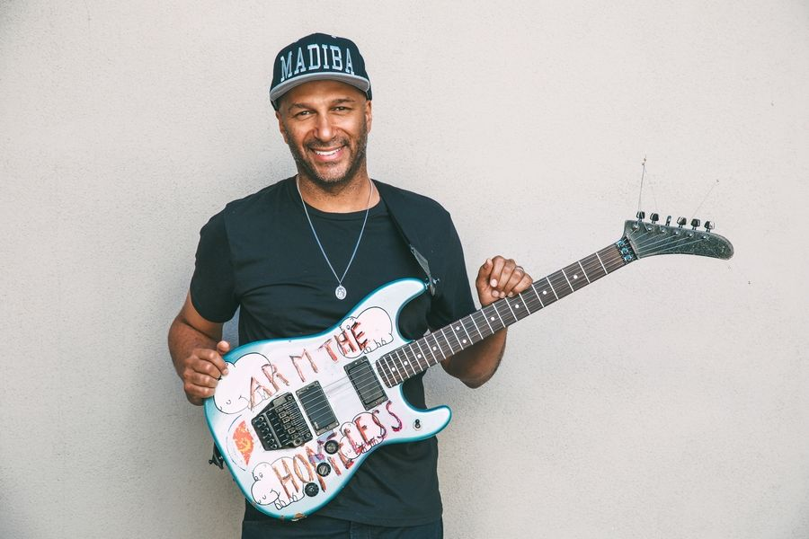 They met as musical children of Libertyville High School teachers. Now, guitar legend Tom Morello donated this autographed guitar to help drummer Bret Zwier of Antioch raise funds for his son, Beckham, who was born with a devastating disorder.