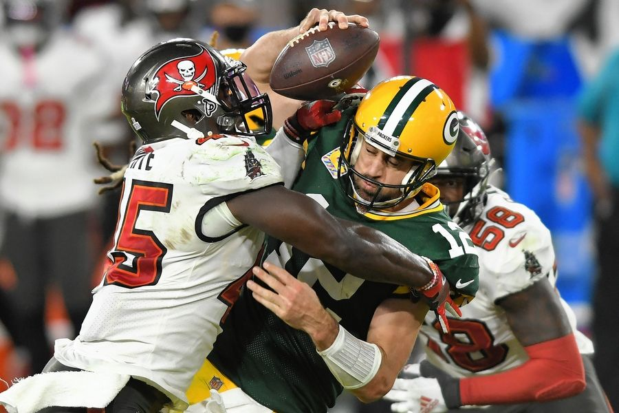 FILE -- Tampa Bay Buccaneers inside linebacker Devin White (45) sacks Green Bay Packers quarterback Aaron Rodgers (12) during the second half of an NFL football game in Tampa, Fla., in this Sunday, Oct. 18, 2020, file photo. Rodgers had his worst game of the season in Green Bay's 38-10 loss at Tampa Bay Back on Oct. 18, as he threw two game-changing interceptions and completed less than half his pass attempts. Rodgers gets a chance to make amends for that performance Sunday when the top-seeded Packers host the Bucs in the NFC Championship Game.