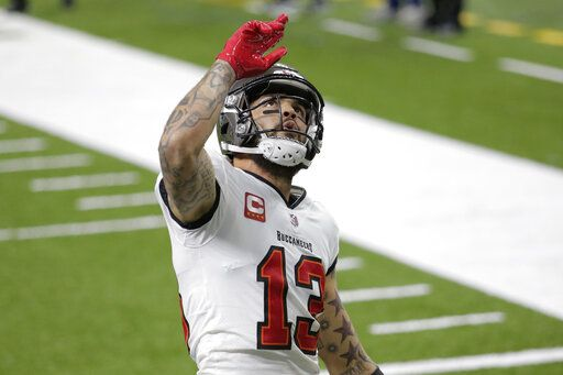Tampa Bay Buccaneers wide receiver Mike Evans (13) celebrates his touchdown against the New Orleans Saints during the first half of an NFL divisional round playoff football game, Sunday, Jan. 17, 2021, in New Orleans.