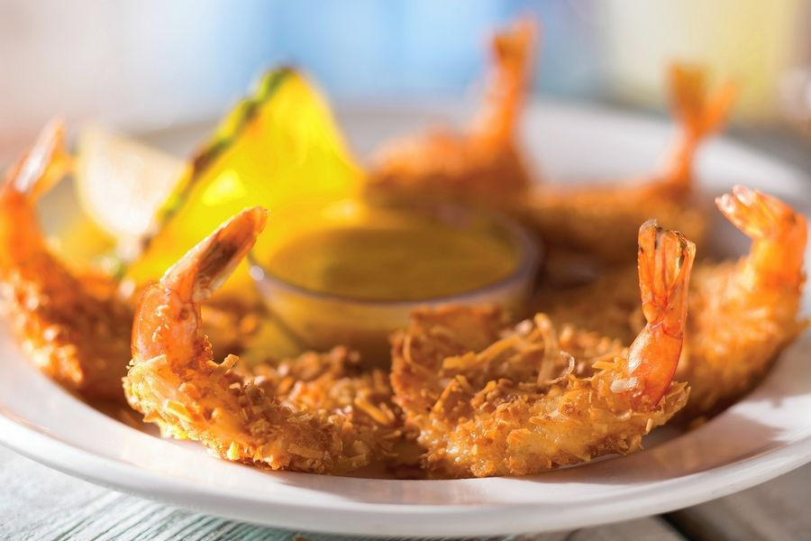 An order of coconut shrimp from Bahama Breeze in Schaumburg gives diners a culinary escape when they can't jet off to an island paradise.