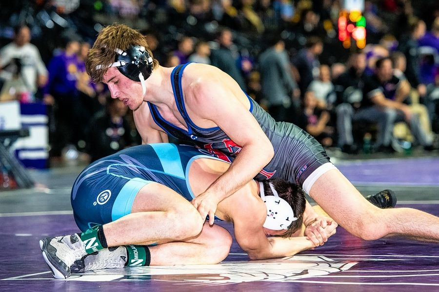 Northwestern wrestler Trevor Chumbley, right, is hoping to crack the starting lineup this season. He's a Marmion graduate.