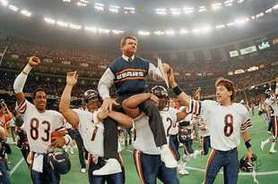 Bears head coach Mike Ditka is carried off the field by Steve McMichael, left, and William Perry after the Bears defeated the New England Patriots 46-10 in Super Bowl XX in New Orleans.