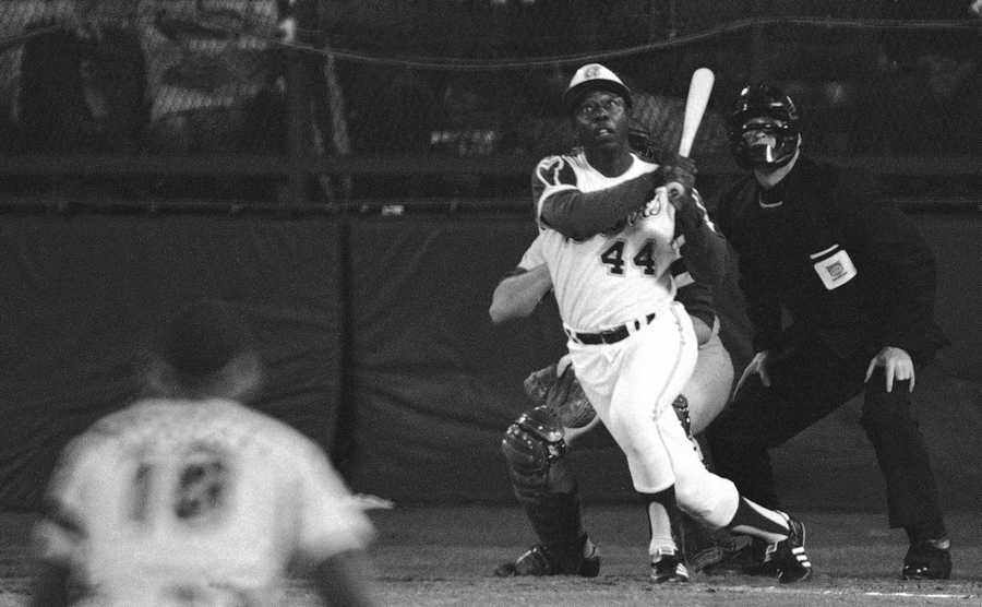 In this April 8, 1974 file photo, Atlanta Braves' Hank Aaron eyes the flight of the ball after hitting his 715th career homer in a game against the Los Angeles Dodgers in Atlanta. The 40th anniversary of Hank Aaron's 715th home run finds the Hall of Famer, now 80, coping with his recovery from hip surgery. The anniversary of his famous homer on April 8, 1974 will be celebrated before the Braves' home opener against the Mets on Tuesday night.