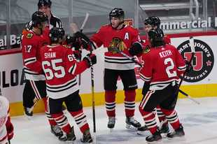 The Hawks prevailed 4-1 in their home opener against the Red Wings on Friday night, getting stellar goaltending from Kevin Lankinen and goals from Patrick Kane, Calvin de Haan and Andrew Shaw. It was their first victory of the young season after dropping four games (one in overtime) at Tampa Bay and Florida.