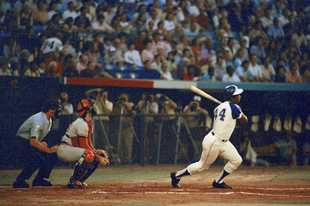 "Hank Aaron hits his 713th home run, en route to breaking Babe Ruth's lifetime record of 714, Sept. 19, 1973, Atlanta, Ga. Aaron, one of major-league baseball's all-time greats, died Friday at the age of 86. ""He was an icon,"" former White Sox shortstop/manager Ozzie Guillen said. ""He was a great human being."""
