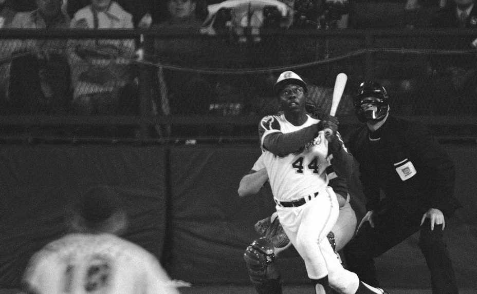 The Atlanta Braves' Hank Aaron eyes the flight of the ball after hitting his 715th career homer in a game against the Los Angeles Dodgers in Atlanta. Aaron died Friday morning at 86.