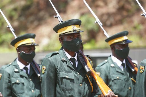 "Soldiers stand guard while attending a state burial of government ministers who died of COVID-19, in Harare, Thursday, Jan. 21, 2021. Zimbabwean President Emmerson Mnangagwa who presided over the burial called the pandemic ""evil"" and urged people to wear masks, practice social distancing and sanitize, as cases across the country increased amid a fragile health system."