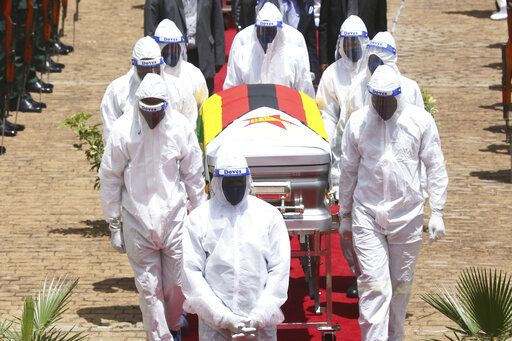 "burial of Dr Ellen Gwaradzimba who died of COVID-19, at the Heroes Acre in Harare, Thursday, Jan. 21, 2021. Zimbabwean President Emmerson Mnangagwa who presided over the burial called the pandemic ""evil"" and urged people to wear masks, practice social distancing and sanitize, as cases across the country increased amid a fragile health system."