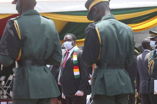 "Zimbabwe President Emmerson Mnangagwa attends the burial of Dr Ellen Gwaradzimba who died of COVID-19, at the Heroes Acre in Harare, Thursday, Jan. 21, 2021. Zimbabwean President Emmerson Mnangagwa who presided over the burial called the pandemic ""evil"" and urged people to wear masks, practice social distancing and sanitize, as cases across the country increased amid a fragile health system."