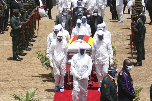 "Pallbearers carry the coffin of government minister Dr Ellen Gwaradzimba who died of COVID-19, in Harare, Thursday, Jan. 21, 2021. Zimbabwean President Emmerson Mnangagwa who presided over the burial called the pandemic ""evil"" and urged people to wear masks, practice social distancing and sanitize, as cases across the country increased amid a fragile health system."