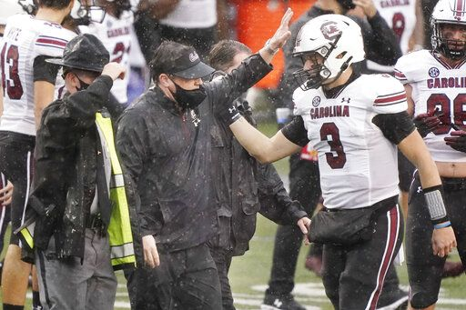 South Carolina head coach Will Muschamp celebrates with quarterback Ryan Hilinski (3) after South Carolina defeated Vanderbilt 41-7 in an NCAA college football game Saturday, Oct. 10, 2020, in Nashville, Tenn.