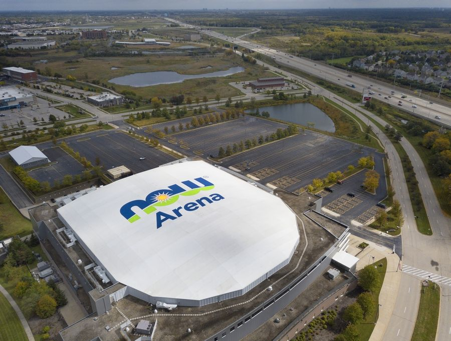 The former Sears Centre is now titled the Now Arena as workers switched the signs on Monday.