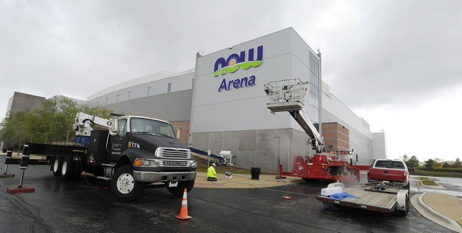 Workers from Omega Sign and Lighting from Addison wire up the new Now Arena signs on the east side of the former Sears Centre. At left, the NOW Manufacturing and Testing Campus, S. Glen Ellyn Road, Bloomingdale.