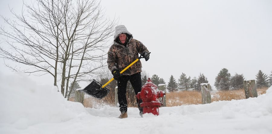 "Vito Manola of Palatine spent time digging out the fire hydrant across the street from his house Tuesday morning. ""We needed a good snow,"" he said as he scraped and brushed snow off the hydrant. ""It's awesome today."""