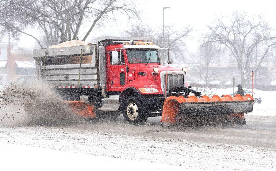 An Elgin snowplow makes its way along Larkin Avenue Tuesday morning after several inches of snow fell overnight.