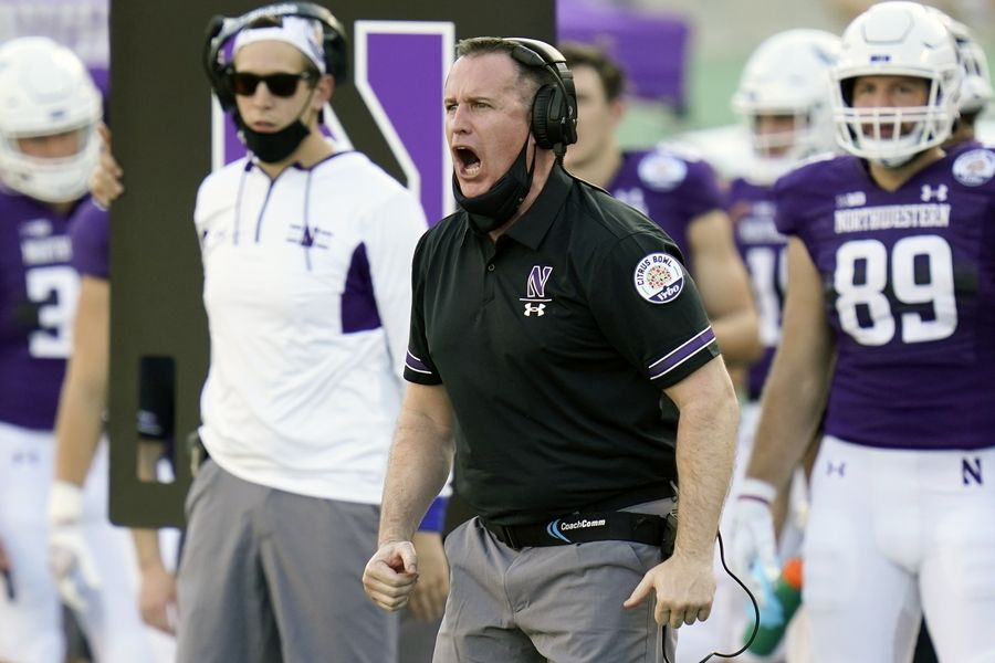 Northwestern coach Pat Fitzgerald, encouraging his players in the Citrus Bowl, has signed a deal to stay in Evanston through 2030.