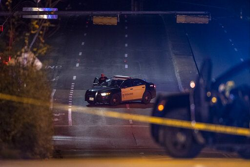 A street is closed off as police respond to hostage situation at a doctor's office in Austin, Texas, Tuesday, Jan. 26, 2021. Austin police said two people were found dead after authorities made entry into the building. (Ricardo B. Brazziell/Austin American-Statesman via AP)