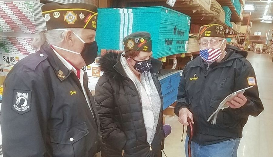 Jerry Gold, left, commander of the Arnold/Heath Memorial VFW Post 5151 in Streamwood, along with fellow members Tonya Frosheiser and Dick Hopple, visit the Home Depot in Schaumburg for the store's donation of a $1,000 grant for the post's Operation Airlift, which benefits soldiers deployed overseas.