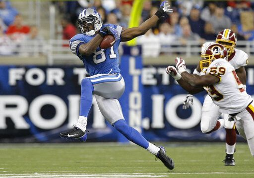 FILE - In this Oct. 26, 2008, file photo, Detroit Lions wide receiver Calvin Johnson makes catch against the Washington Redskins during the fourth quarter of an NFL football game in Detroit. Johnson has been named to the Pro Football Hall of Fame in his first year of eligibility, Saturday, Feb. 6, 2021.