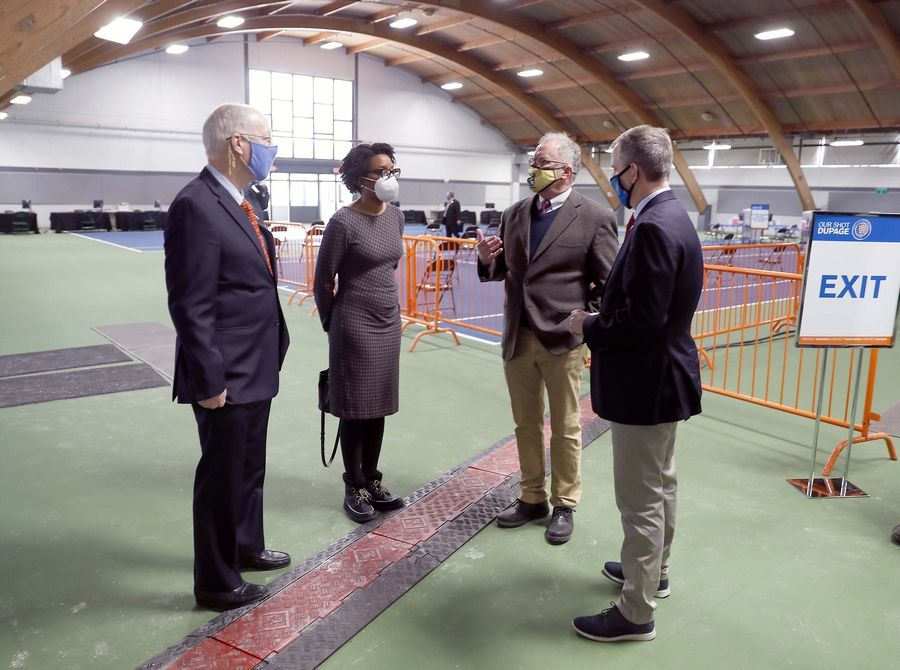 From left, U.S. Rep Bill Foster, U.S. Rep. Lauren Underwood, DuPage County Board Chairman Dan Cronin and U.S. Rep. Sean Casten tour a new COVID-19 vaccination clinic opening at the DuPage County Fairgrounds in Wheaton.