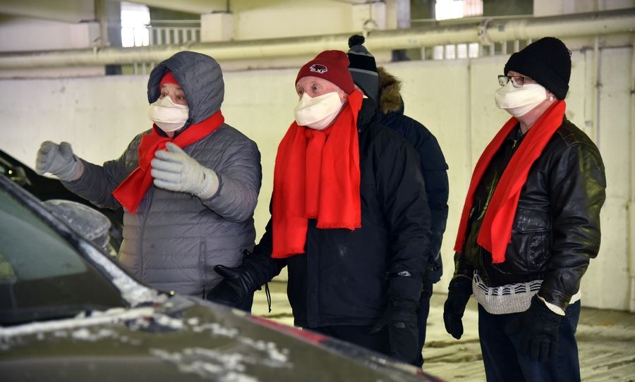 From left to right, singers Al Thorstenson of Huntley, Mike Johnston of Arlington Heights, Aaron Madsen of Prospect Heights and Dave Theile of Rolling Meadows, braved Sunday's subzero temperatures to perform in the Arlingtones Barbershop Chorus' drive-through Valentine's Day concert in Palatine.