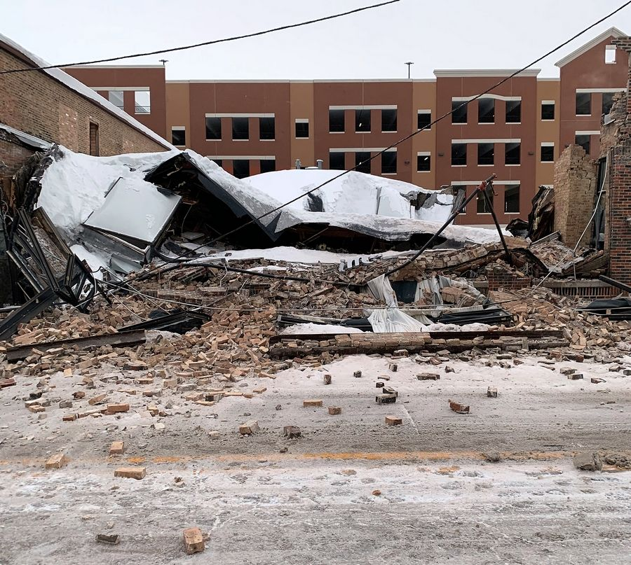 COURTESY OF ELGIN FIRE DEPARTMENTThe building that housed Imago Events at 216 Spring St. in Elgin collapsed Monday morning, likely from an accumulation of snow and ice on the roof, fire officials said.