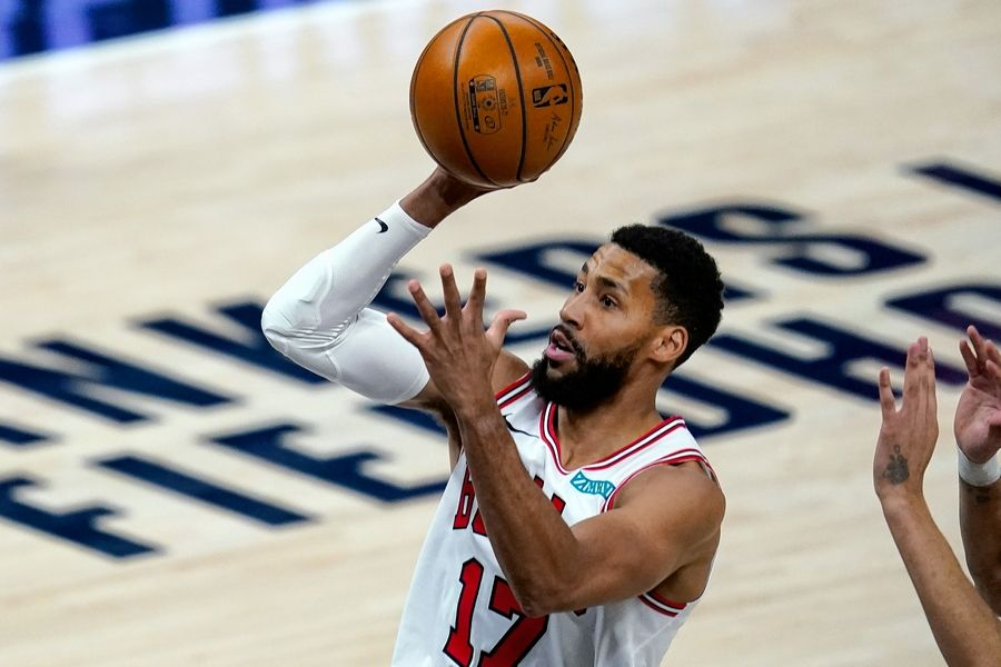 Bulls guard Garrett Temple (17) shoots against the Indiana Pacers on Monday, Feb. 15, 2021, in Indianapolis. Temple said he feels like a big brother to players like Coby White.