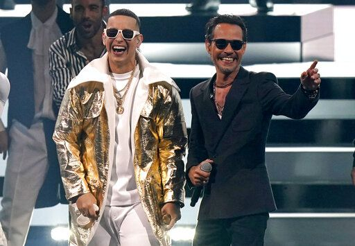Daddy Yankee, left, and Marc Anthony perform at Premio Lo Nuestro at American Airlines Arena, Tuesday, Feb. 16, 2021, in Miami. The award show airs on Feb. 18 with both live and prerecorded segments.