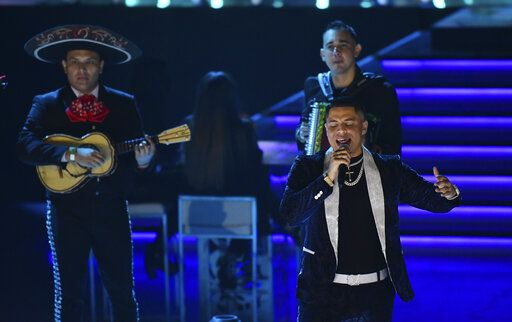 Grupo Firme performs at Premio Lo Nuestro at American Airlines Arena on Sunday, Feb. 14, 2021, in Miami. The award show airs on Feb. 18 with both live and prerecorded segments.