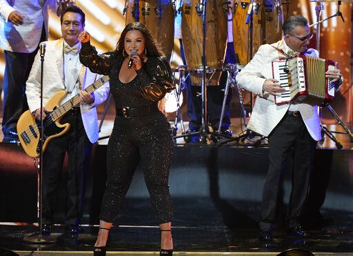 Chiquis Rivera, center, and Los Angeles Azules perform at Premio Lo Nuestro at American Airlines Arena on Thursday, Feb. 18, 2021, in Miami.