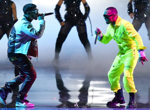 Anuel AA, left, and Ozuna perform at Premio Lo Nuestro at American Airlines Arena, Tuesday, Feb. 16, 2021, in Miami. The award show airs on Feb. 18 with both live and prerecorded segments.
