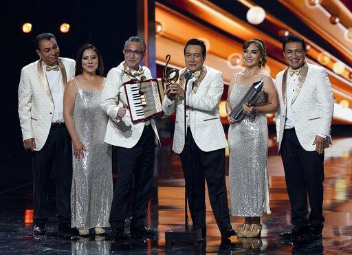 Los Angeles Azules accept the Legado Music Award at Premio Lo Nuestro at American Airlines Arena on Thursday, Feb. 18, 2021, in Miami.