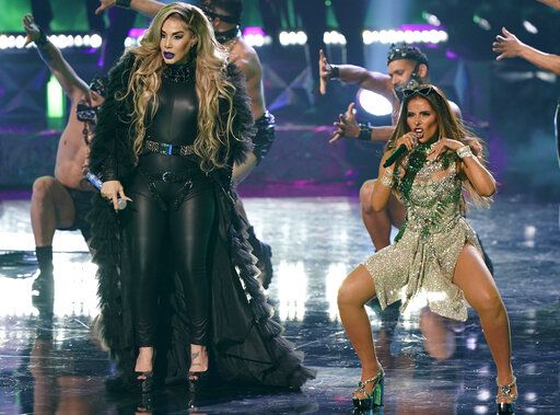 Ivy Queen, left, and Gloria Trevi perform at Premio Lo Nuestro at American Airlines Arena on Thursday, Feb. 18, 2021, in Miami.