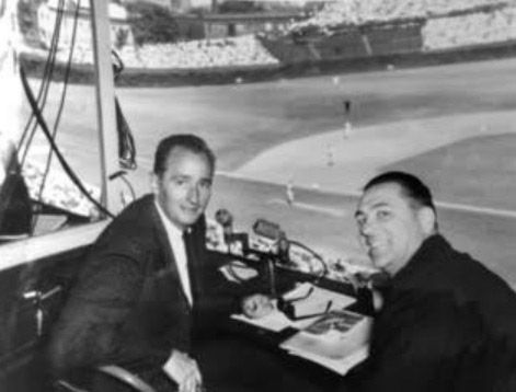 Photo courtesy of Ron Barber and Susan QuinlanJack Quinlan (left) and Lou Boudreau in the broadcast booth at Wrigley Field.