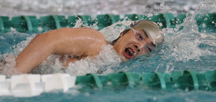 Vernon Hills' Ethan Phua swims freestyle in the 200-yard individual medley during the Lake County boys swimming meet at Stevenson High School in Lincolnshire Saturday.
