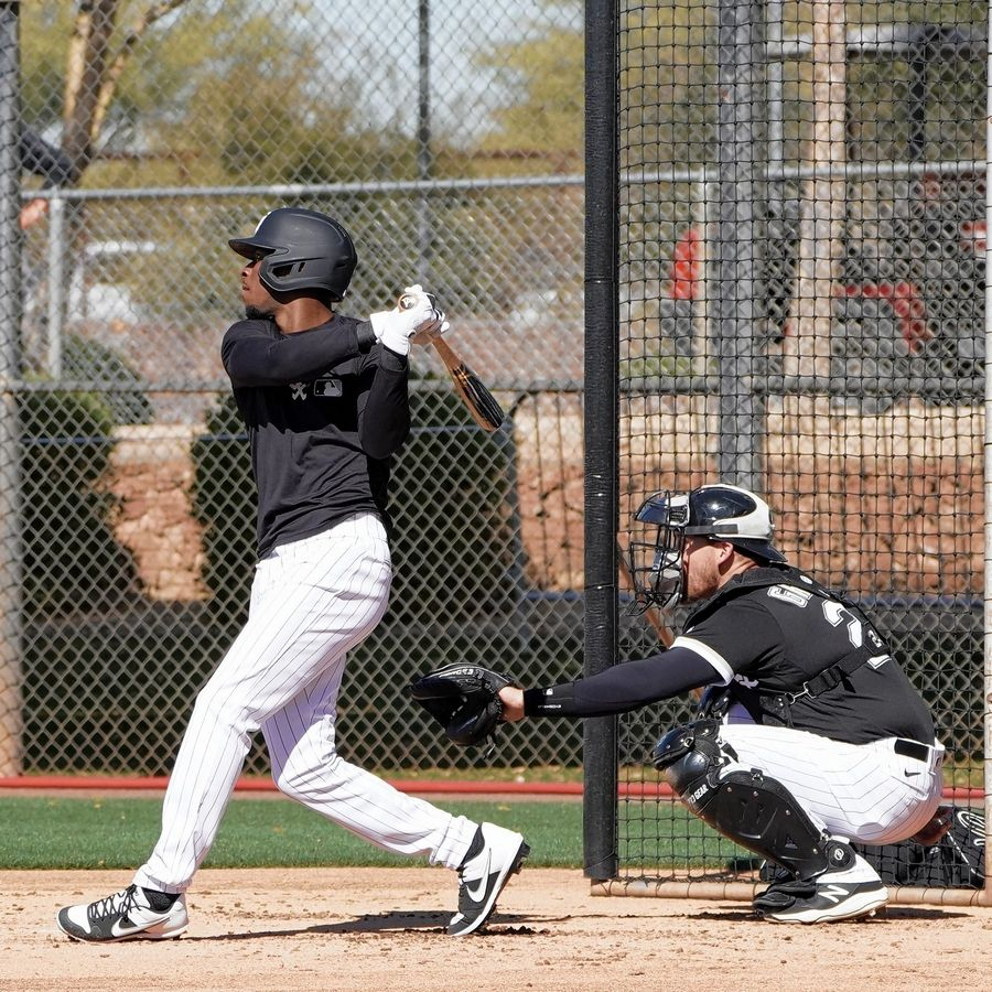 Tim Anderson takes some swings Monday in Glendale, Ariz., with Yasmani Grandal catching.