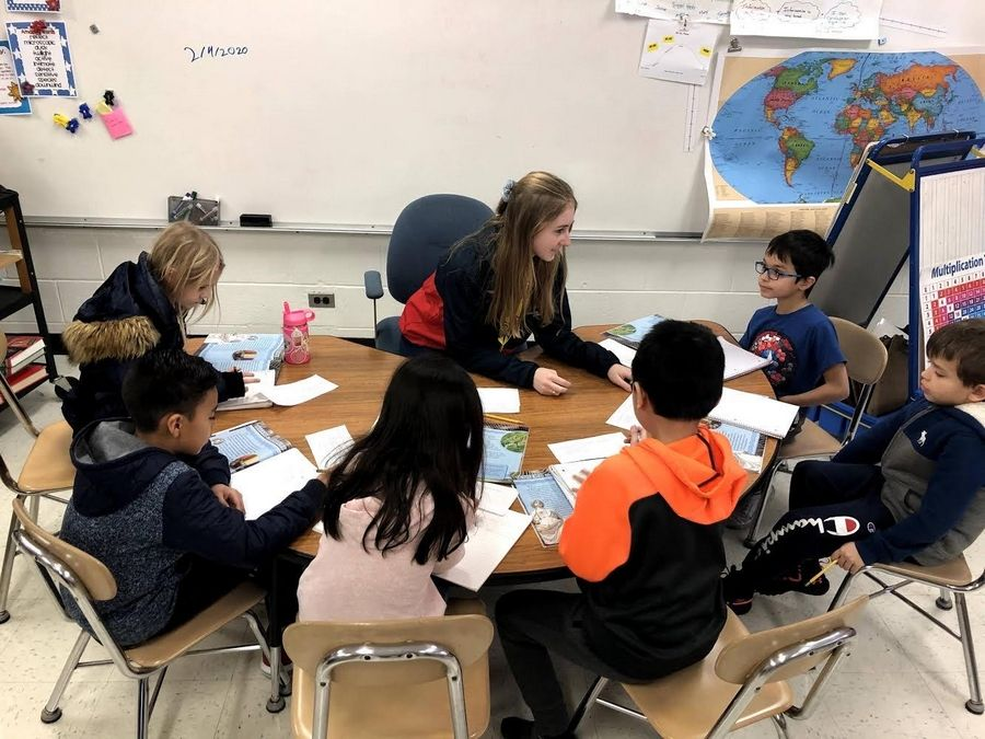 Wheeling High School senior Stephanie Tadda works with students as part of her work-based learning experience through District 214.