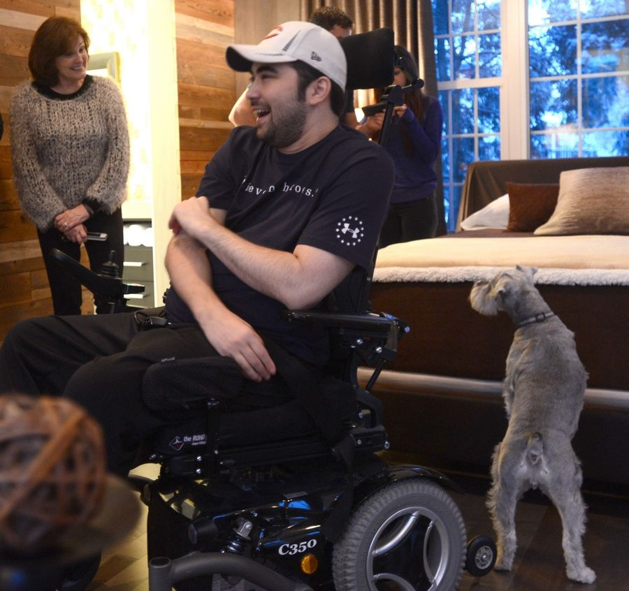 Dan Tsutsumi, seen here after a 2013 makeover of his Arlington Heights home, served two tours of duty with Marines in Iraq, before he was paralyzed in 2012 while diving in Lake Michigan. His determination earned him a Socrates Award from the Brennan Rehabilitation Foundation.