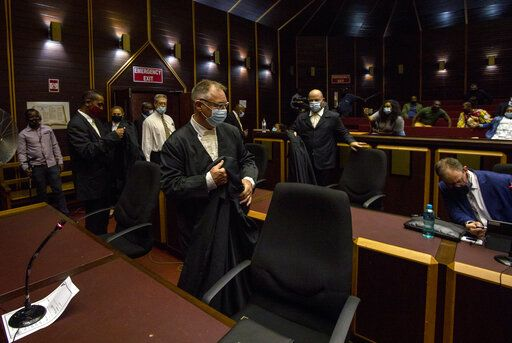 Legal teams arrive at the High Court in Pietermaritzburg, South Africa, Tuesday, Feb. 23, 2021. A South African judge said he will file a criminal complaint against former South African president Jacob Zuma after he staged a dramatic walkout while attending a commission of inquiry looking into corruption during his tenure from 2009 to 2018.