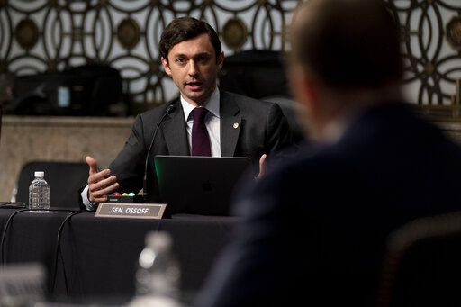 Sen. Jon Ossoff, D-Ga., questions former U.S. Capitol Police Chief Steven Sund, foreground, during a Senate Homeland Security and Governmental Affairs & Senate Rules and Administration joint hearing on Capitol Hill, Washington, Tuesday, Feb. 23, 2021, to examine the January 6th attack on the Capitol.
