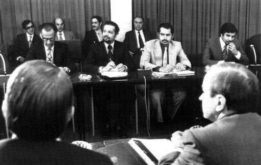 FILE - In this Oct. 8, 1973, file photo, oil ministers of six Persian Gulf countries and representatives of western nations meet in Vienna, Austria, to negotiate price boosts sought by oil producers. Facing each other, are from left to right, Dr. Jamshid Amouzegar, then Iran Finance Minister, then Saudi Oil Minister Ahmed Zaki Yanani. Yamani, a long-serving oil minister in Saudi Arabia who led the kingdom through the 1973 oil crisis, the nationalization its state energy company and later found himself kidnapped by the assassin Carlos the Jackal, died Tuesday, Feb. 23, 2021, in London. He was 90.